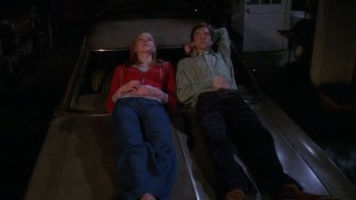 Donna (Laura Prepon) and Eric (Topher Grace) share a memorable moment on the hood of the Vista Cruiser in the pilot episode.
