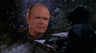 Red (Kurtwood Smith) appears to Eric as a vision in the snow of the gang's ski trip.