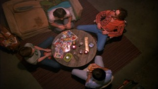 The guys convene in Eric's basement for one of their smoky circle sessions.
