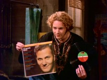 Hyde (Danny Masterson) teaches Fez how to sneak heavy metal past his hosts: with a Pat Boone album jacket.