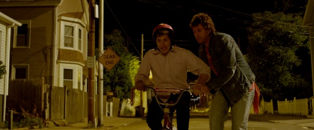 Donny (Adam Sandler) seizes their night together to teach Todd (Andy Samberg) to ride a bike.
