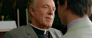 James Caan has a minor but funny role as Father McNally, an Irish priest who isn't afraid to get violent.