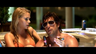 Donny (Adam Sandler) defends his son's lack of athleticism and voices his appreciation for older women in this extended hot tub scene.