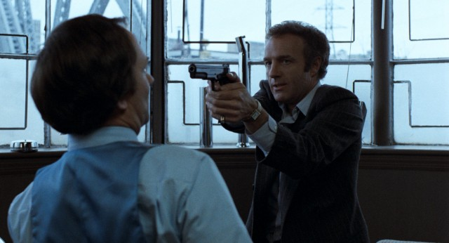 Frank (James Caan) proves he's not monkeying around by pointing a gun at the plating company executive who owes him money.
