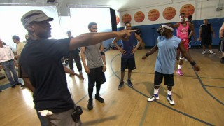 Tim Story directs a scene that pits cast members against professional basketball players including Metta World Peace and Lisa Leslie.