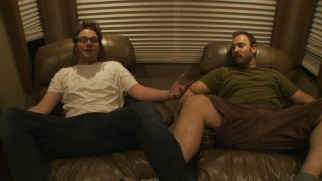 "Seth Rogen and Evan Goldberg strike an interesting pose to discuss ""Directing Your Friends."""