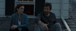 Siblings Wendy (Tina Fey) and Judd (Jason Bateman) have a heart-to-heart talk on the roof.