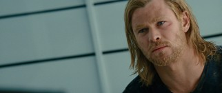 Stripped of his armor and some of his power, Thor (Chris Hemsworth) is questioned by S.H.I.E.L.D. Agent Phil Coulson.