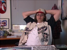 "Director Donovan Cook proves he's the right man for the job with a Mickey Mouse baseball jersey in ""Get the Scoop."""