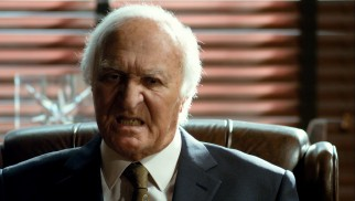 Robert Loggia channels his dark side as enraged CEO Tommy Schlaaang Jr.