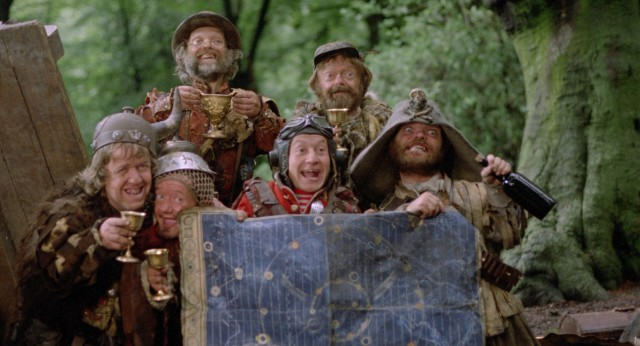 The Time Bandits take group photo with stolen treasures and the map they use to travel through time.
