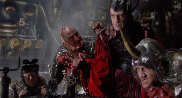 Surrounded by idiots, the genius Evil (David Warner) finds it difficult to lure the Time Bandits to the Fortress of Ultimate Darkness.