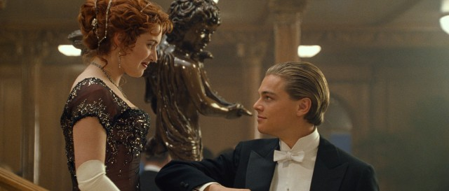 Fixed up for his meal in first class, Jack Dawson (Leonardo DiCaprio) extends a forearm to Rose DeWitt Bukater (Kate Winslet).