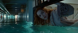 Rose (Kate Winslet) braves high and rising waters in an attempt to rescue a handcuffed Jack.