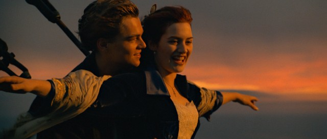 Jack (Leonardo DiCaprio) and Rose (Kate Winslet) enjoy a magical sunset at the bow of the Titanic in one of the most iconic and infamous scenes of the film.