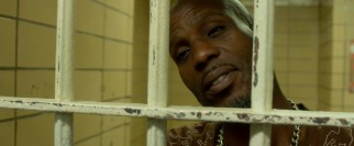 Rapper DMX makes fun of his legal problems and himself in his imprisoned appearance.