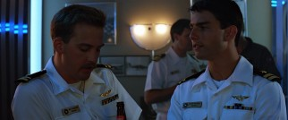 Best friends Goose (Anthony Edwards) and Maverick (Tom Cruise) sample the Top Gun night life.