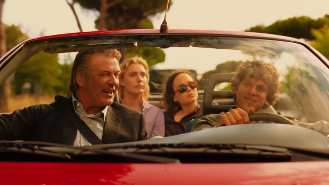 John (Alec Baldwin) continues to share his surreal wisdom with Jack (Jesse Eisenberg) as they take a picturesque drive around Rome.