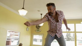 A sandwich spear is a dangerous weapon in the hand of Harland Williams.