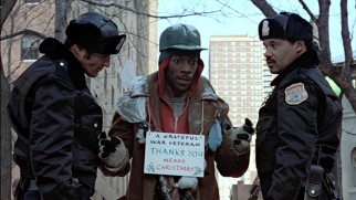 In his second film role, Eddie Murphy plays Billy Ray Valentine, a Philadelphia street beggar to whose deceptions the police are wise.