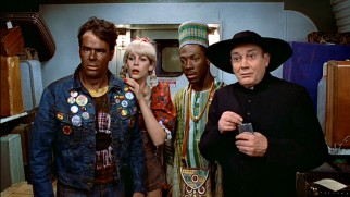 Louis (Dan Aykroyd), Ophelia (Jamie Lee Curtis), Billy Ray (Eddie Murphy), and Coleman the butler (Denholm Elliott) play dress-up as part of their climactic New Year's Eve train ride scheme.