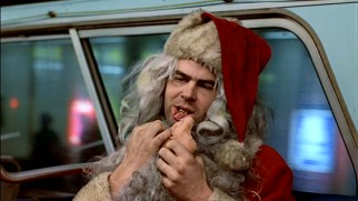 Louis Winthorpe III (Dan Aykroyd) has seen better Christmases than the one that finds him eating stolen salmon out of a filthy Santa Claus costume beard.