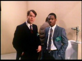 Dan Aykroyd and Eddie Murphy promote their film from a bathroom for the annual ShoWest exhibitors' convention in Las Vegas.