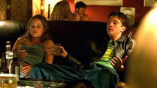Representing the youth, wealthy teenaged prep school students Caroline (Erika Christensen) and her semi-boyfriend Seth (Topher Grace) unwind with alcohol and hard drugs.