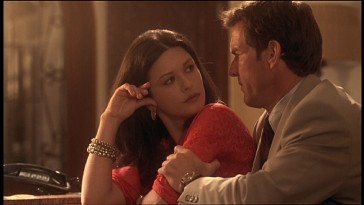 Lawyer/confidante Arnie Metzger (Dennis Quaid) provides a comforting grip in one of Helena Ayala's (Catherine Zeta-Jones) numerous deleted scenes.