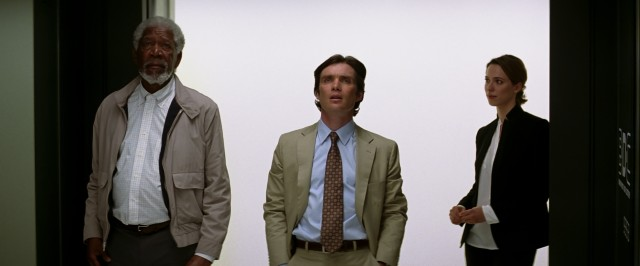 Evelyn Caster (Rebecca Hall) shows Joseph Tagger (Morgan Freeman) and FBI Agent Buchanan (Cillian Murphy) the data supercenter her late husband presides over.