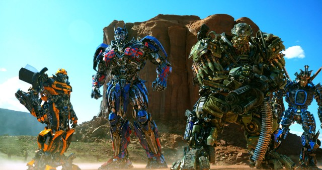 Surviving Autobots Bumblebee, Optimus Prime, Hound, and Drift assemble in the desert.