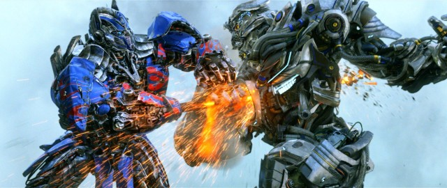 Optimus Prime strikes Galvatron in his empty soul in this visual effects action shot.