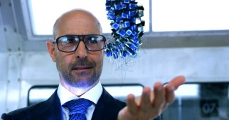 Billionaire visionary Joshua Joyce (Stanley Tucci) marvels at the game-changing technology his company is developing.
