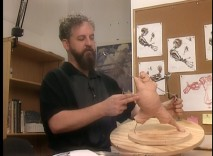 "Kent Melton works on a Long John Silver character sculpture in ""Maquettes."""