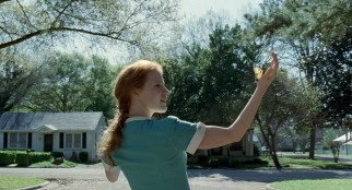 Representing the Grace to her husband's Nature, Mrs. O'Brien (Jessica Chastain) catches a butterfly on her hand.