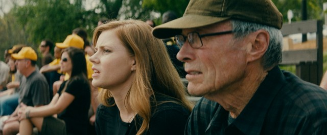 "In ""Trouble with the Curve"", Mickey Lobel (Amy Adams) joins her aging father (Clint Eastwood) in North Carolina to do some baseball scouting together."