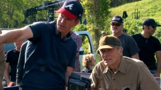 "Robert Lorenz directs in an Atlanta Braves hat, while a knowing Clint Eastwood looks on in ""Rising Through the Ranks."""
