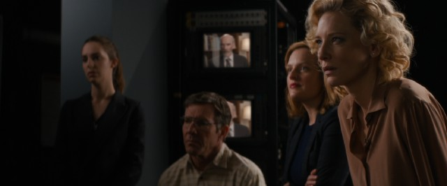 Mary Mapes (Cate Blanchett) and her staff (Dennis Quaid and Elisabeth Moss) watch as their report is called into question.
