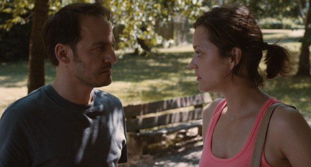 "Manu (Fabrizio Rongione) and Sandra (Marion Cotillard) share a moment outside in ""Two Days, One Night."""