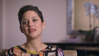 Marion Cotillard uses perfect English in her interview.