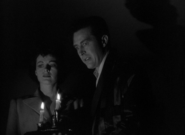"Siblings and housemates Pamela (Ruth Hussey) and Roderick Fitzgerald (Ray Milland) get a fright in the middle of the night in the 1944 ghost thriller ""The Uninvited."""