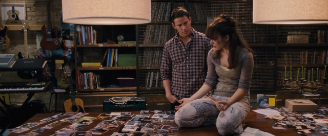 Paige (Rachel McAdams) hopes that a table full of photographs will help jog her memory, something of interest to her forgotten husband (Channing Tatum).