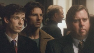 In this deleted scene, David (Tom Cruise) looks in on his own memorial service between tech support (Noah Taylor) and his lawyer (Timothy Spall).