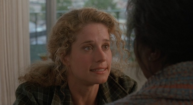 In an attempt to save the day, Rita Baker (Nancy Travis) questions her crazy Elvis-worshipping neighbor.