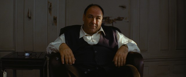 With bullet holes around but not in him, The Guy (James Gandolfini) awaits the fate he's accepted.