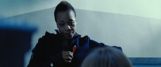 1990s Academy Award nominee Marianne Jean-Baptiste appears briefly as the lollipop-twirling, advice-dispatching top-ranked assassin in Violet and Daisy's outfit.