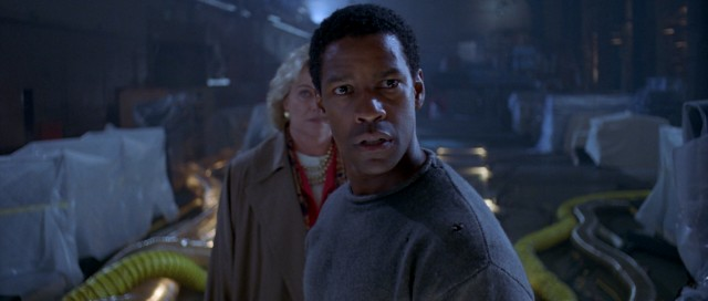 """Virtuosity"" stars Denzel Washington as Parker Barnes, an LAPD detective turned prison inmate set free to capture a computer-engineered menace."