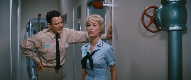 Because no submarine would be complete without romance, Captain Lee Crane (Robert Sterling) and Admiral's secretary Cathy Connors (Barbara Eden) are engaged to be married.