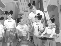 Jimmie helps the Mouseketeers form a gadget band.
