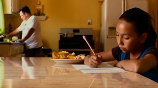 "Seen here doing her homework, Daisy Esparza is one of five elementary school students whose search for a better education is documented in ""Waiting for 'Superman'."""